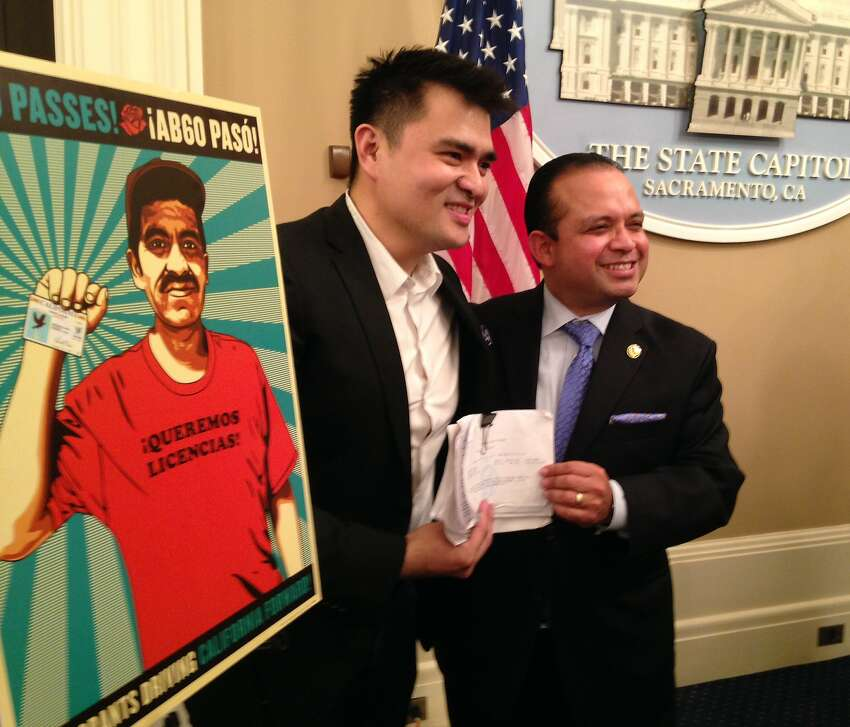 Jose Antonio Vargas, left, shows his new driver's license with Assemblyman Luis Alejo, D-Watsonville, who author the bill that made it possible. Vargas, a Filipino-born journalist who moved to the Bay Area when he was 12, was thrust into the spotlight in 2011 when he revealed in a New York Times magazine cover story that he was living in the United States without legal permission. On Thursday, the Mountain View Whisman School District board voted to name a new school after Vargas. (File photo)