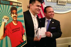 Jose Antonio Vargas shares his new license with the author of the law that made it possible, Assemblyman Luis Alejo, D-Watsonville. Vargas, a Filipino-born journalist who moved to the Bay Area when he was 12, was thrust into the spotlight in 2011 when he revealed in a New York Times magazine cover story that he was living in the United States without legal permission.
