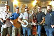 Wires and Wood band members Ben Wolff, Brian White, Matt Lauretano and Ben Boylan are greeted by Brewery Legitimus owner Chris Sayer.