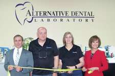 OPEN WIDE: From left, North Haven First Selectman Michael Freda; Paul Mancini and Lois Carle, owners of Alternative Dental Lab; and Quinnipiac Chamber of Commerce Executive Director Dee Prior-Nesti were on hand for the grand opening of Alternative Dental Lab at 110 Republic Drive in North Haven. According to a release, the business has been serving dentists in the state for 30 years, from crowns to full implants. Visit www.alternativedentallab.com.