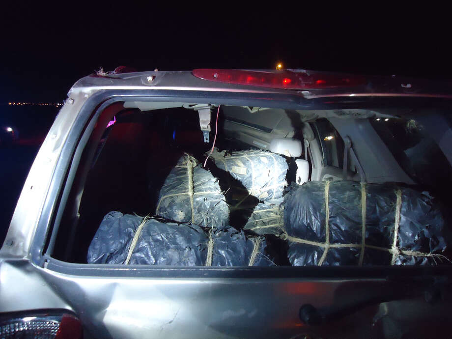 Border Patrol said it found five bundles of marijuana in a vehicle after it rolled over on Mines Road at about 9:20 p.m. Thursday, June 14, 2018. The driver of the SUV, a U.S. citizen, was pronounced dead at the scene. Photo: Border Patrol, Courtesy Photo