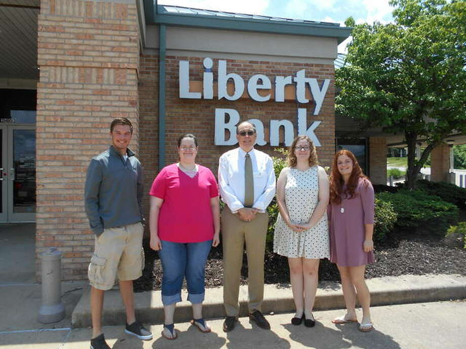 Liberty Bank President Dale Blachford, center, with the four Liberty Bank Scholarship Award winners, from left, Brock Seymour of Southwestern High School, Kathleen Botterbush of Marquette Catholic High School, Anna Sawyer of Alton High School, and Cassandra Reed of Civic Memorial High School. Photo:       For The Telegraph