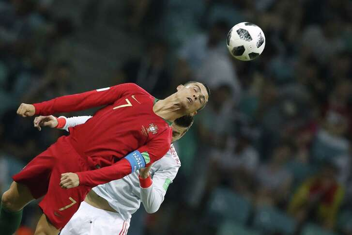 Portugal's forward Cristiano Ronaldo heads the ball during the Russia 2018 World Cup Group B football match between Portugal and Spain at the Fisht Stadium in Sochi on June 15, 2018. / AFP PHOTO / Odd ANDERSEN / RESTRICTED TO EDITORIAL USE - NO MOBILE PUSH ALERTS/DOWNLOADSODD ANDERSEN/AFP/Getty Images