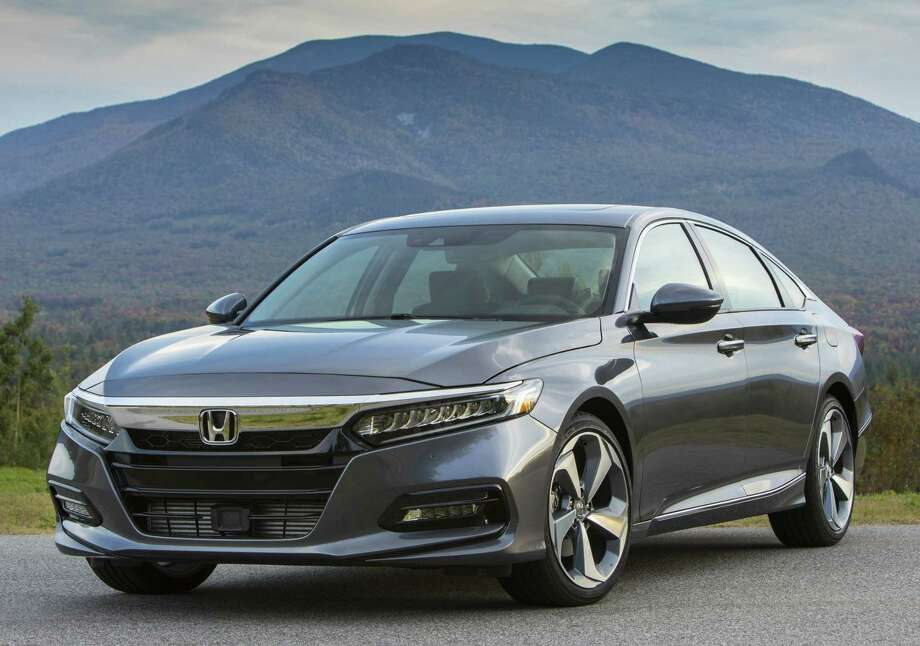 "The Accord, which marked its 40th anniversary in the U.S. last year, is virtually all new or ""substantially re-engineered,"" Honda said. As before, it comes in gasoline-only and gasoline-electric hybrid versions. Photo: Honda"
