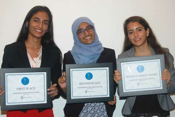 Top winners at the Bruce Museums Phenomenon Science Innovation Fair, from left, are Raina Jain, Hiba Hussain, and Emily Philippides.
