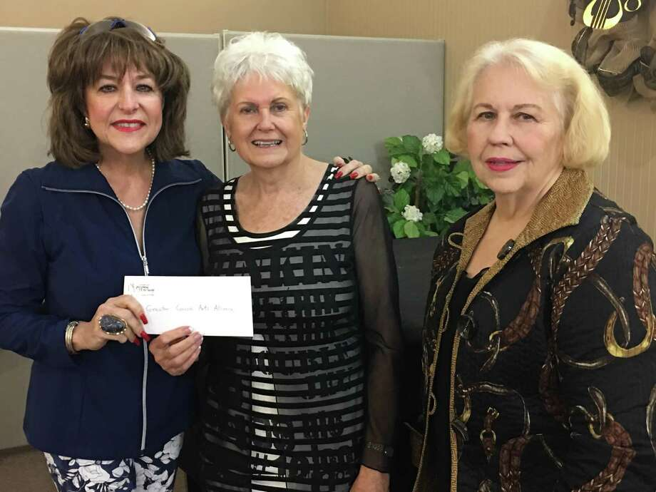 Pictured from left are BJ Ordner (MCPAS), Annette Spikes (GCAA), and Frances Peoples of MCPAS. After 40 years, the Montgomery County Performing Arts society is disbanding due to the increased costs of professional performing entertainers and presenting their remaining funds to the Greater Conroe Arts Association(GCAA). Photo: Courtesy Photo