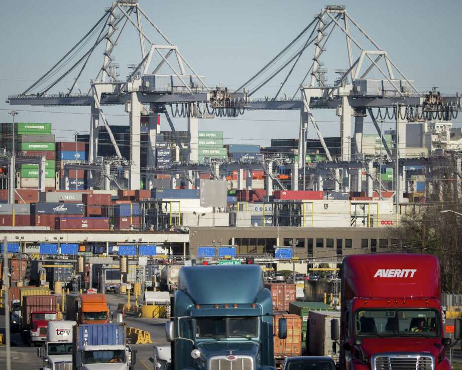 In this Jan. 30, 2018, file photo, tractor-trailer trucks move cargo in shipping containers out of the Port of Savannah in Savannah, Ga. President Donald Trump announced Friday, June 15, 2018, that starting next month the U.S. will impose a 25 percent tariff on up to $50 billion in Chinese imports. Photo: Stephen B. Morton /Associated Press / FR56856 AP