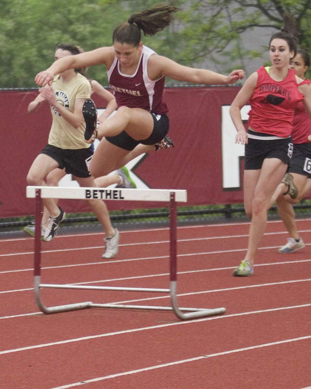 Bethel's Lizzie Morton wins the 300 intermediate hurdles at the SWC Track and Field Championships Monday at Bethel High School.