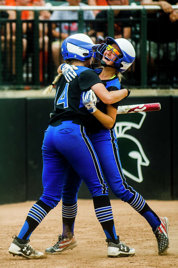 Coleman sophomore Abigail Tubbs, left, hugs junior MacKenzie Miller after Miller scored the first run of the game during the Comets' 2-0 Division 4 state softball semifinals victory over Rogers City on Friday, June 15, 2018 at Michigan State University. (Katy Kildee/kkildee@mdn.net) Photo: (Katy Kildee/kkildee@mdn.net)