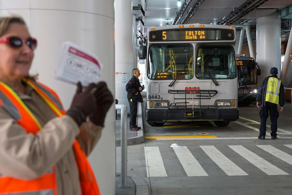 Candy Corbitt, SFMTA brand ambassador, informs commuters and passers-by of the transportation� changes accompanying the opening of the new Transbay Transit Center. On Friday, June 15, 2018 in San Francisco Calif. �