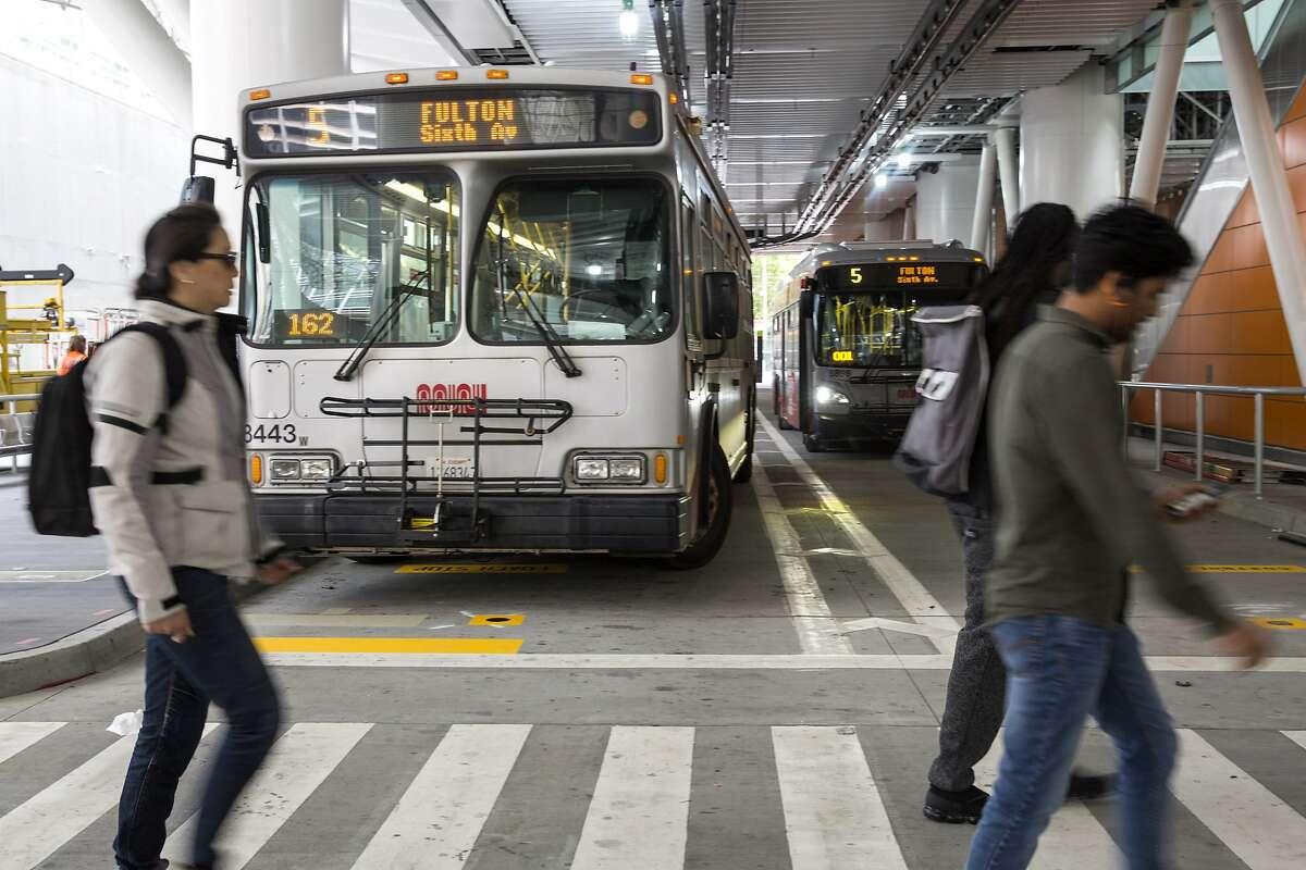 The 5 Fulton bus runs through the Muni Bus Plaza at the new Transbay Transit Center on Friday, June 15, 2018 in San Francisco Calif.