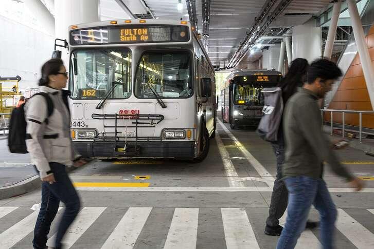 The 5 Fulton bus runs through the Muni Bus Plaza at the new Transbay Transit Center on Friday, June 15, 2018 in San Francisco Calif. �