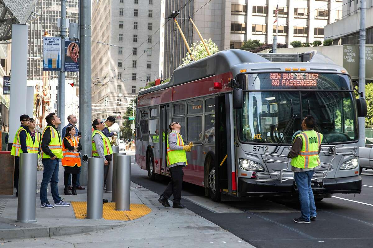 SFMTA transit operations workers test a new vehicle outside the Muni Bus Plaza of the new Transbay Transit Center on Friday, June 15, 2018 in San Francisco Calif.