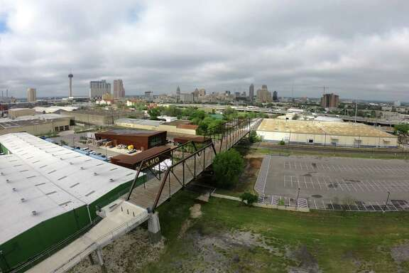Many nearby residents have opposed the five-story complex as a harbinger of gentrification that would block views of the historic Hays Street Bridge.