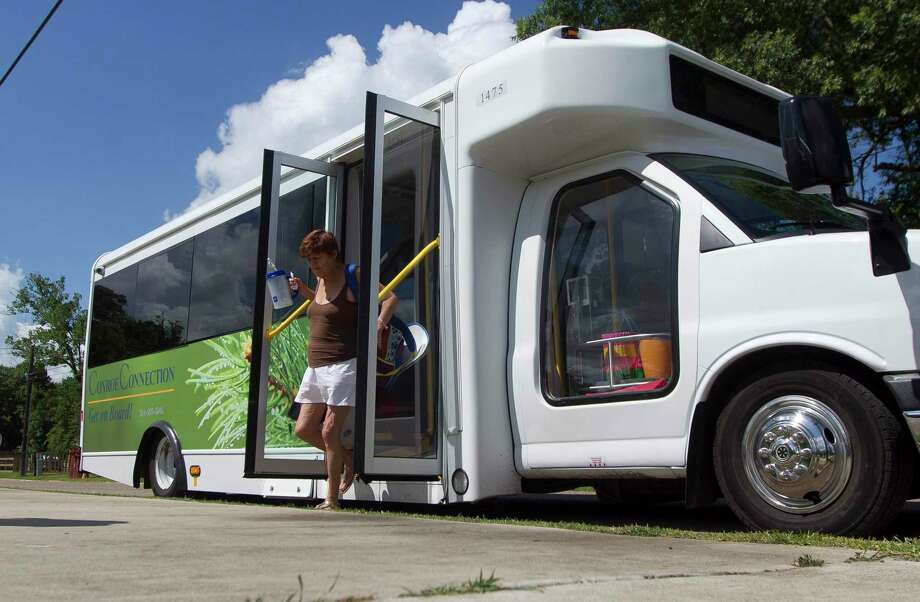 A woman exits a Conroe Connection bus at the city's public transportation stop at Booker T. Washington Park along West Davis Street in this file photo. The city of Conroe is suspending all fares on the Conroe Connection transit service to help residents obtain medical service during the novel coronavirus crisis. Photo: Jason Fochtman, Staff Photographer / Houston Chronicle / © 2018 Houston Chronicle