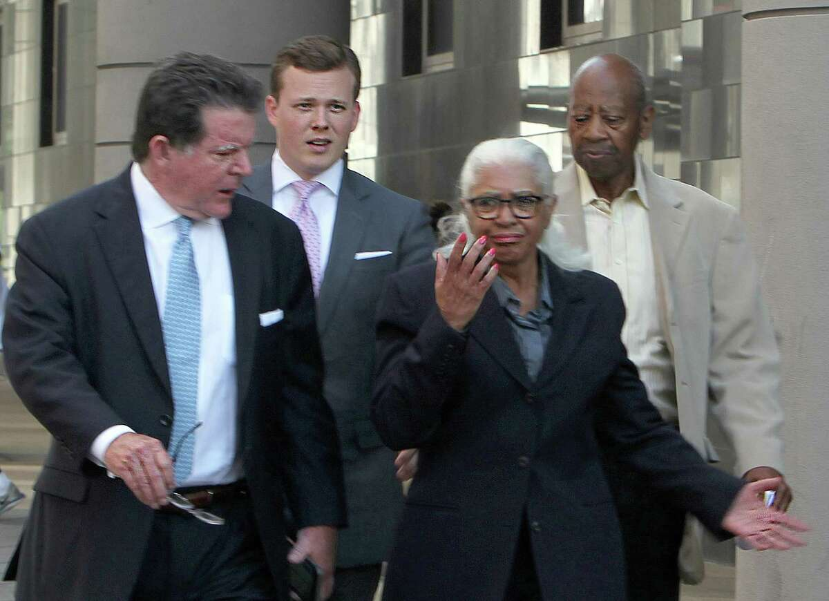 The founding superintendent of Houston's Varnett charter school, Marian Annette Cluff, and her husband, Alsie Cluff Jr., the school's former facilities manager, leave the courtroom with their attorneys, Dan Cogdell and Cordt Akers. The Cuffs turned themselves into federal authorities today after being indicted on charges of embezzling more than $2.6 million intended to benefit impoverished students. Friday, July 17, 2015, in Houston. ( Dylan Aguilar / Houston Chronicle )