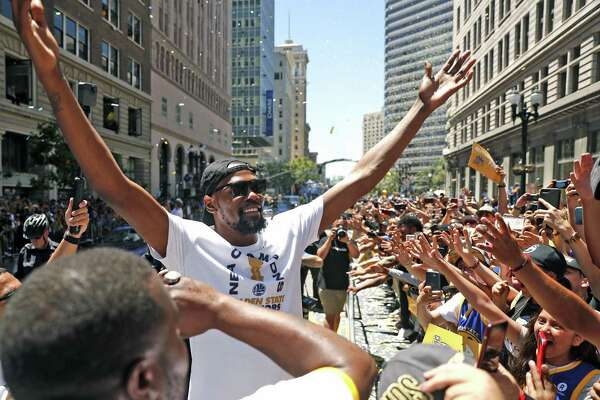 low priced 55443 c2320 1of9Kevin Durant acknowledges the cheers of the crowd lined along Broadway  during Golden State Warriors  NBA Championship parade in Oakland on June  12, ...