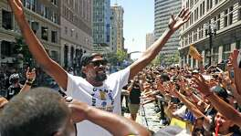Kevin Durant acknowledges the cheers of the crowd lined along Broadway during Golden State Warriors' NBA Championship parade  in Oakland, CA on Tuesday, June12, 2018.