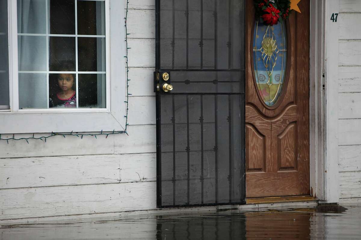 Water is seen risen to the front door of a home at the Le Mar Trailer Park on Friday, December 12, 2014 in Redwood City, Calif.