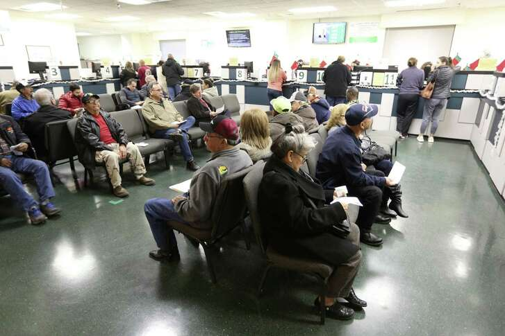 People wait Dec. 28 at the Bexar County Tax Collector-Assessor's office to pay everything from boat and trailer taxes to property taxes. Contrary to a recent letter to the editor by a local candidate, the commissioner's court has held the line on taxes and debt.