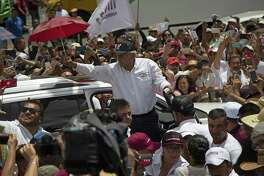 Presidential candidate Andrés Manuel López Obrador, known as AMLO, gestures to supporters as he ends his campaign rally in Mexico City, June 3. Mexico will hold general elections on July 1.