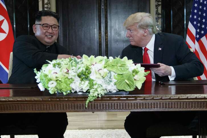 President Donald Trump and North Korean leader Kim Jong Un participate in a signing ceremony during a meeting on Sentosa Island, Tuesday in Singapore. The meeting legitimized a tyrant.