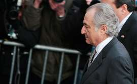 NEW YORK - MARCH 12:  Disgraced financier Bernard Madoff passes a police barricade as he arrives at court March 12, 2009 in New York City.  Madoff was expected to plead guilty to all 11 felony charges brought by prosecutors on financial misdoings, and could end up with a sentence of 150 years in prison.  (Photo by Chris Hondros/Getty Images)