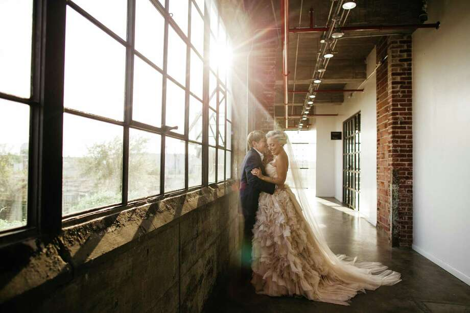 Jenny Block and Robin Brown tie the knot at the Astorian Photo: Lisa Hause Photography / Amber Elliott / Steven.F.Gruesen