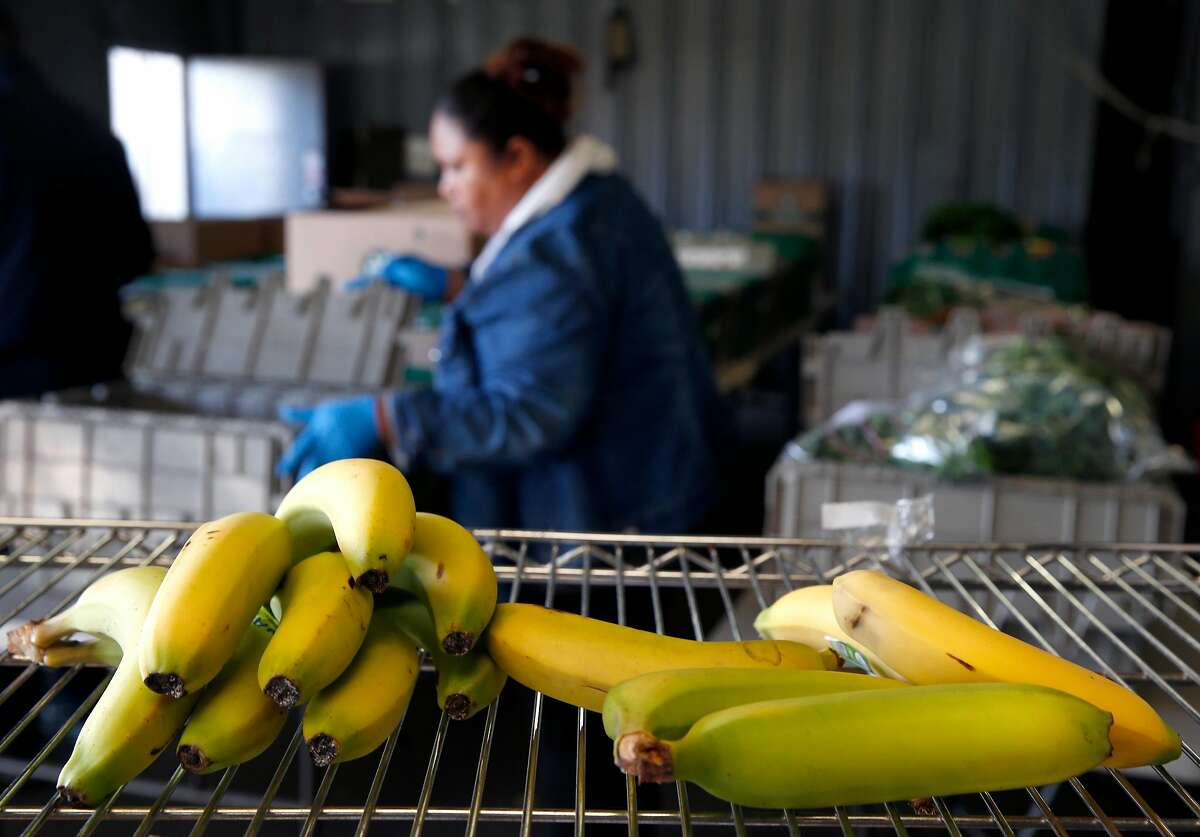 Plastic bins of produce are prepared for delivery to customers at the GrubMarket warehouse in San Francisco, Calif. on Friday, June 15, 2018.