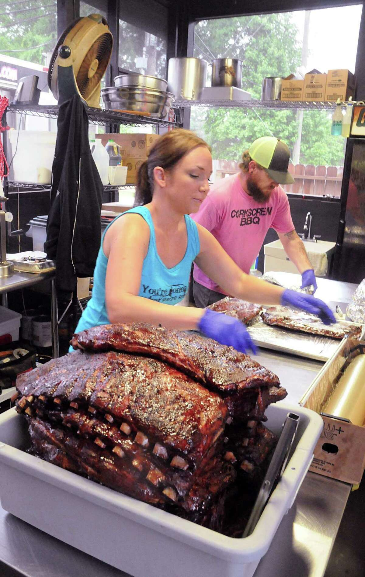 Nichole and Will Buckman wrap to go barbecue rib orders at their Corkscrew BBQ.
