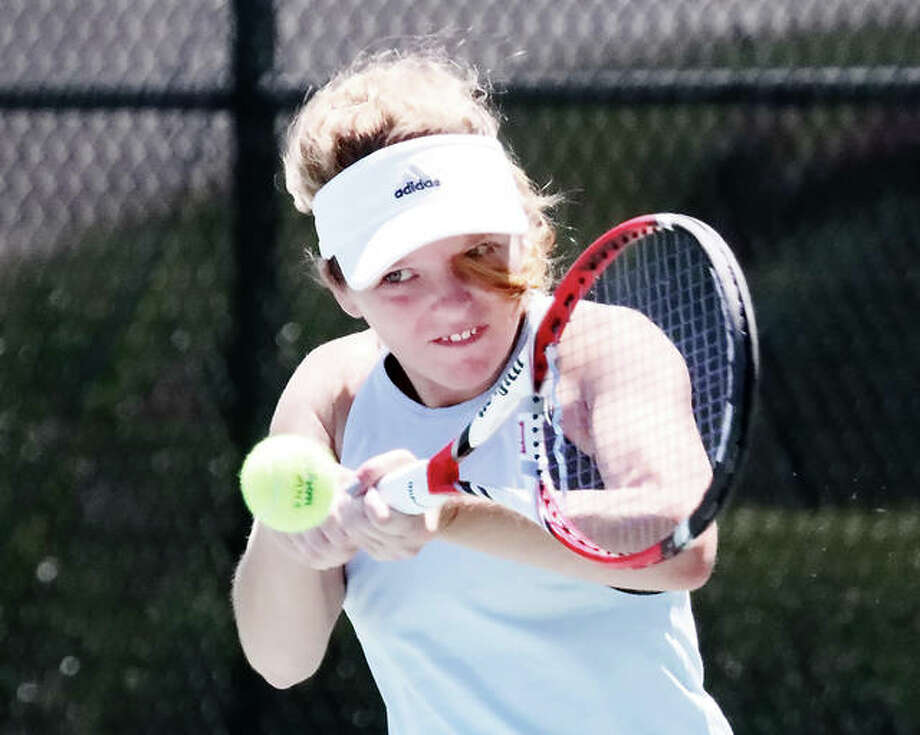 Janelle Wilson, of Godfrey, makes a return against Princess Imoukhuede in last year's Women's Open Singles final of the Bud Simpson Open tournament at Lewis and Clark Community College. This year's tourney is set for June 22-24 at LCCC. Photo:       Telegraph File Photo