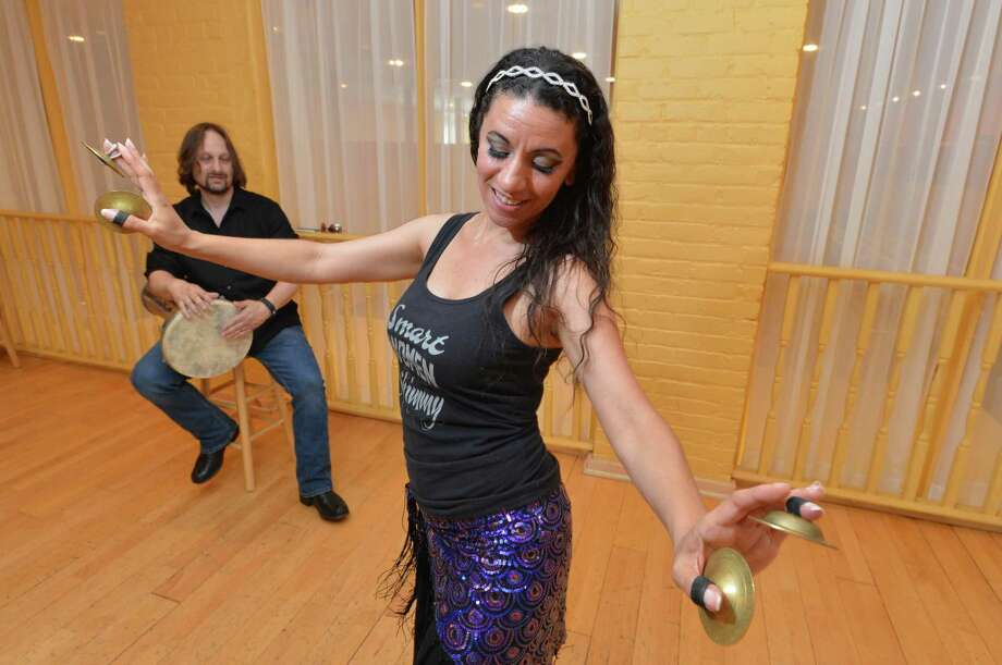 Dancer Tava Naiyan rehearses a Traditional Turkish dance as her husband Peter Auslan keeps beat on the Dombek at Dance Dimensions in Norwalk Conn. on Thursday June 14, 2018. Tava will be one of the many performers at the upcoming Nice Festival Photo: Alex Von Kleydorff / Hearst Connecticut Media / Norwalk Hour