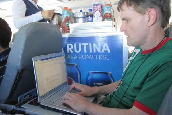 Ed Walsh comfortably working with a full size laptop in a standard economy class seat on Interjet