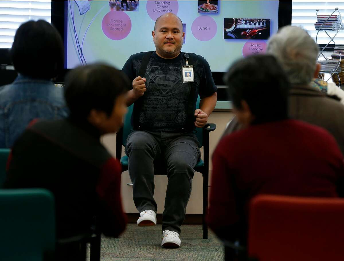 Arnel Valle conducts a dance movement program for clients at an On Lok senior center on Bush Street in San Francisco, Calif. on Friday, June 15, 2018. Valle recently completed training on caring for LGBT seniors with dementia.