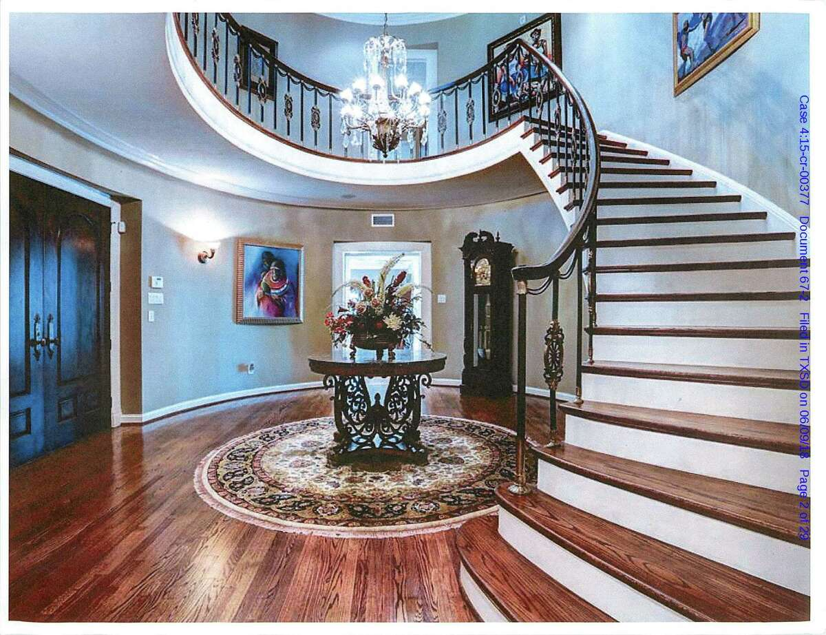 A foyer in the south Houston home owned by Varnett charter school founders Alsie Cluff Jr. and Marian Annette Cluff, who are expected to sell the property to help pay $4.4 million in restitution. The couple has pleaded guilty to federal charges in connection with a $2.6 million embezzlement scheme that bilked taxpayers and parents with children attending the school. They have agreed to pay back the money, plus $1.8 million in unpaid taxes, interest and penalties.