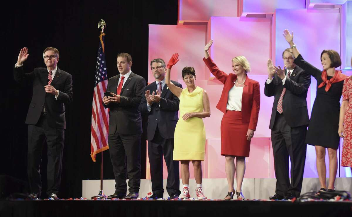 Republican state representatives join Lt. Gov. Dan Patrick, left, onstage at the Republican Party of Texas convention at the Henry B. Gonzalez Convention Center on Friday, June 15, 2018.