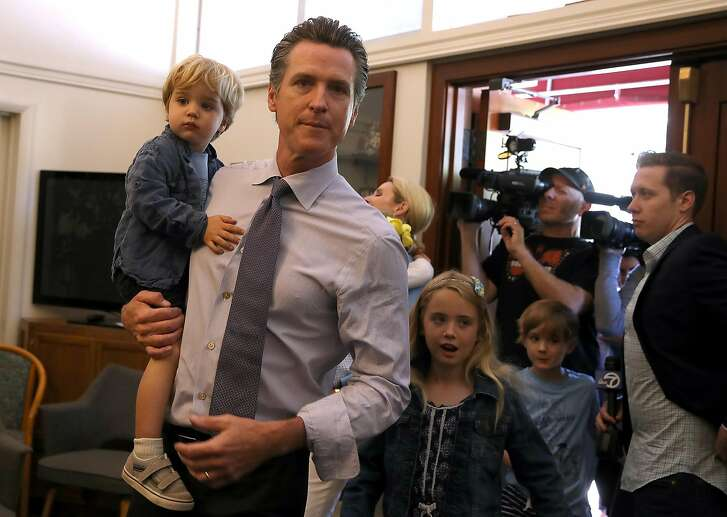 LARKSPUR, CA - JUNE 05:  Democratic gubernatorial candidate Lt. Gov. Gavin Newsom (C) walks with his kids Dutch, (L) Montana (2R) and Hunter (R) before voting at the Masonic Temple Fairfax on June 5, 2018 in Larkspur, California.  California Lt. Gov. Gavin Newson cast his ballot as California voters are heading to the polls to vote in the primary election. Newsom is expected to claim the top spot in the California gubernatorial primary election ahead of republican candidate John Cox and former Los Angeles mayor Antonio Villaraigosa, a democrat.  (Photo by Justin Sullivan/Getty Images)
