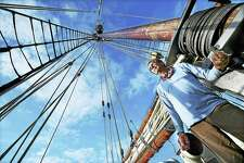 Senior Deck Hand Evan who lives full-time on the Freedom Schooner Amistad, beneath the one-hundred foot mast, is back in the vessel's homeport at Long Wharf Pier in New Haven, Wednesday, October 12,2016. The Freedom Schooner Amistad, the official tallship and flagship ambassador of the state of Connecticut is a replica vessel launched in March 2000 and serves as a symbol of the human strugglefor freedom. (Catherine Avalone/New Haven Register)