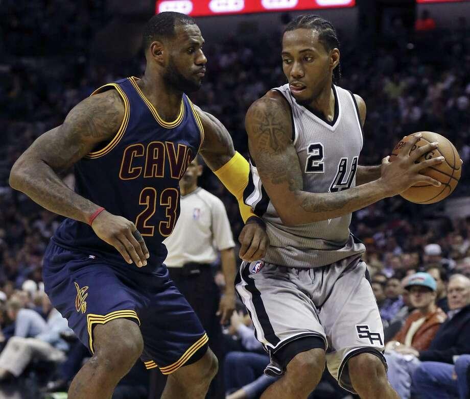 Cleveland Cavaliers' LeBron James defends San Antonio Spurs' Kawhi Leonard during first half action Thursday March 12, 2015 at the AT&T Center. Photo: Edward A. Ornelas, Staff / San Antonio Express-News / © 2015 San Antonio Express-News