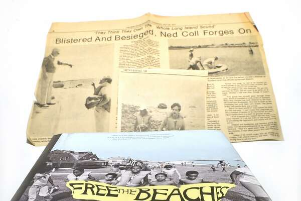 New Haven, Connecticut - June 12, 2018: The jacket cover of Andrew W. Kahrl's book chronicling Ned Coll's fight for access to Connecticut beaches on Long Island Sound and New Haven Register reporter Randall Beach's stories from the 1970s on Coll's activism.