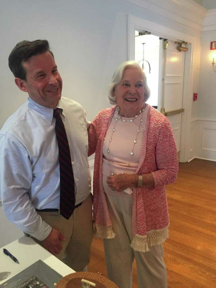 Greenwich resident and author Matt Bernard meets with Belle Haven resident Judy Higgins, his former neighbor, at a book signing to benefit Community Centers Inc. at the Belle Haven Club. Photo: Contributed /