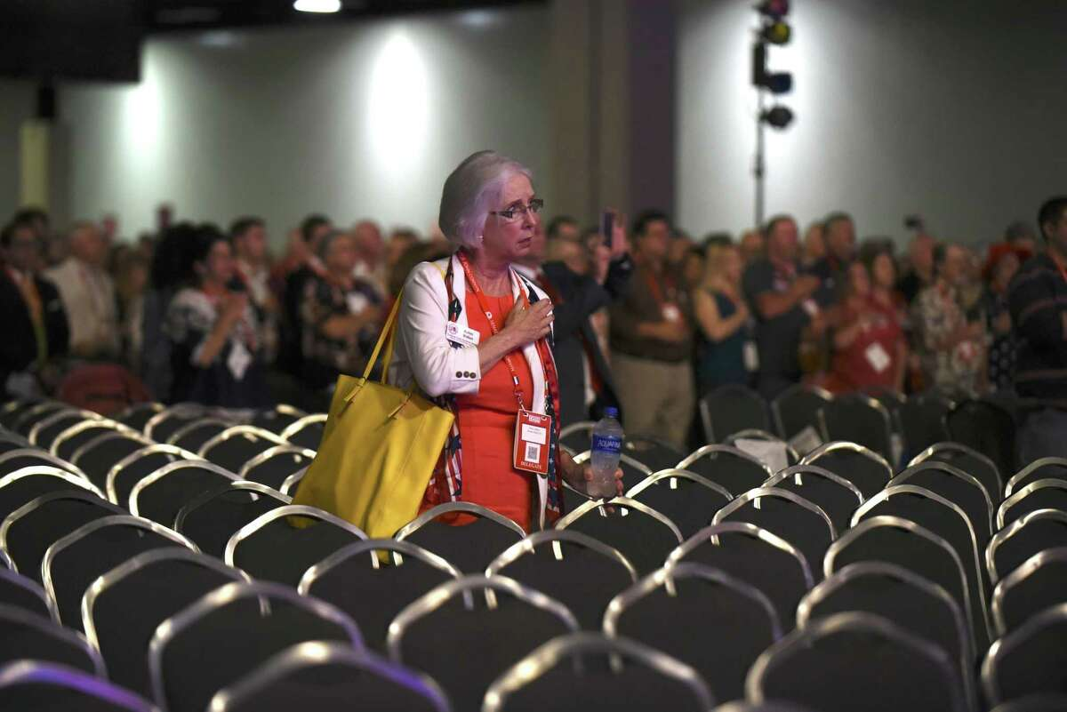 Robin Walker recites the Pledge of Allegiance at the Republican Party of Texas convention at the Henry B. Gonzalez Convention Center on Friday, June 15, 2018. Gov. Greg Abbott spoke shortly afterward.