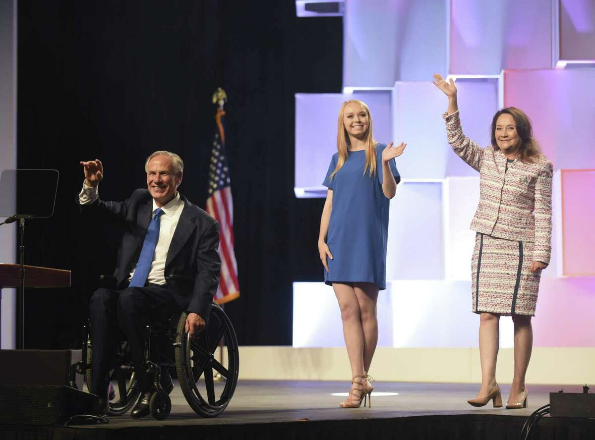 Gov. Greg Abbott, left, his wife, Cecilia, right, and daughter, Audrey, middle, greet the audience at the Republican Party of Texas convention at the Henry B. Gonzalez Convention Center on Friday, June 15, 2018.