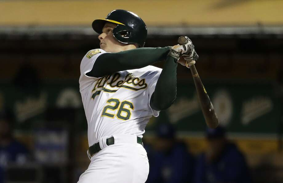 Oakland Athletics' Matt Chapman follows through on an RBI double against the Kansas City Royals during the sixth inning of a baseball game Thursday, June 7, 2018, in Oakland, Calif. (AP Photo/Marcio Jose Sanchez) Photo: Marcio Jose Sanchez / Associated Press