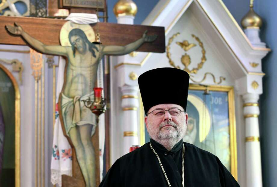 Rev. Terenti Wasielewski stands inside St. Nicholas Russian Orthodox Church on Thursday, June 14, 2018, in Cohoes, N.Y. (Will Waldron/Times Union) Photo: Will Waldron