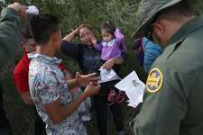 """MCALLEN, TX - JUNE 12:  U.S. Border Patrol agents ask a group of Central American asylum seekers to remove hair bands and weddding rings before taking them into custody on June 12, 2018 near McAllen, Texas. The immigrant families were then sent to a U.S. Customs and Border Protection (CBP) processing center for possible separation. U.S. border authorities are executing the Trump administration's """"zero tolerance"""" policy towards undocumented immigrants. U.S. Attorney General Jeff Sessions also said that domestic and gang violence in immigrants' country of origin would no longer qualify them for political asylum status.  (Photo by John Moore/Getty Images)"""