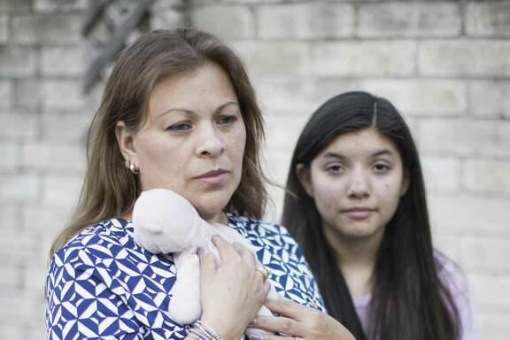 Accompanied by her younger daughter Nicole Baez, right, Janina Baez holds the stuffed animal her older daughter Britney Baez received at the hospital when she was born in 2001. Britney was killed in a car crash on May 27. 13 days after the accident, her father Mario Baez also died due to injuries he suffered when the vehicle they were in was impacted by a drunk driver. Wednesday, June 13, 2018, in Houston. ( Marie D. De Jesús / Houston Chronicle )