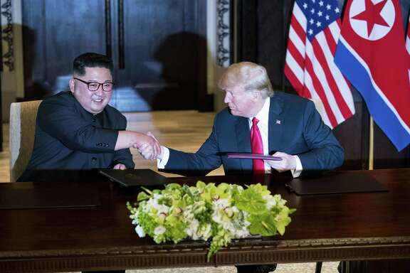 President Donald Trump and Kim Jong Un of North Korea during a document signing ceremony on Sentosa Island in Singapore on June 12. Since their meeting, a new propaganda film released in North Korea shows Kim as a global leader on an equal footing with Trump.