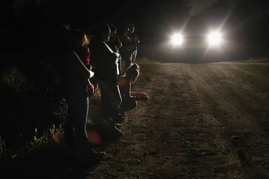"U.S. Border Patrol agents detain a group of Central American asylum seekers near the U.S.-Mexico border on June 12, 2018 in McAllen, Texas. The group of women and children had rafted across the Rio Grande from Mexico and were detained before being sent to a processing center for possible separation. Customs and Border Protection is executing the Trump administration's ""zero tolerance"" policy toward undocumented immigrants. U.S. Attorney General Jeff Sessions also said that domestic and gang violence in immigrants' country of origin would no longer qualify them for political asylum status. Photo: John Moore, Staff / Getty Images / 2018 Getty Images"