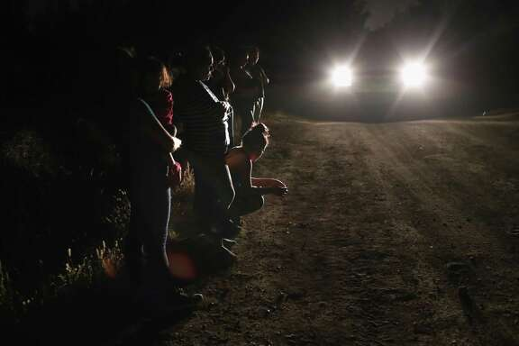 "U.S. Border Patrol agents detain a group of Central American asylum seekers near the U.S.-Mexico border on June 12, 2018 in McAllen, Texas. The group of women and children had rafted across the Rio Grande from Mexico and were detained before being sent to a processing center for possible separation. Customs and Border Protection is executing the Trump administration's ""zero tolerance"" policy toward undocumented immigrants. U.S. Attorney General Jeff Sessions also said that domestic and gang violence in immigrants' country of origin would no longer qualify them for political asylum status."